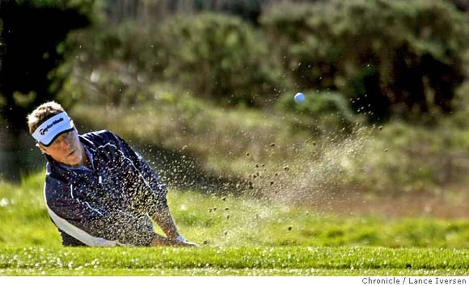 Michael Allen blast out of the trap onto the 1st green at Spyglass Hill Friday morning. The second round of the annual AT&T Pebble Beach National Pro-Am got under way with a number of new names leading the tournament. By Lance Iversen/The Chronicle MANDATORY CREDIT PHOTOG AND SAN FRANCISCO CHRONICLE/NO SALES MAGS OUT Photo: Lance Iversen