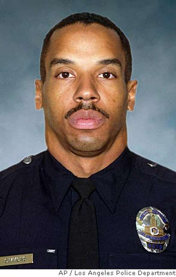 Los Angeles police SWAT officer Randal Simmons, seen in an undated photo released by the Los Angeles Police Department, was killed during a police shoot-out with a gunman early Thursday, Feb. 7, 2008, in Los Angeles. (AP Photo/Los Angeles Police Department)