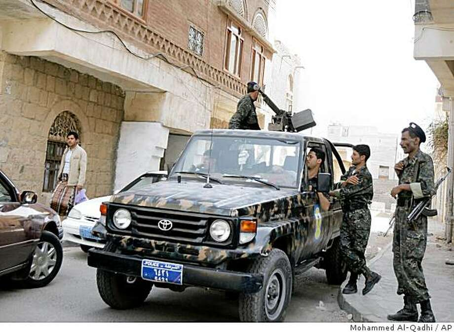 A Yemeni security armored vehicle patrol in the capital San'a, Yemen, Monday, June 15, 2009. Three German women hostages have been found dead early Monday in the rugged Saada mountains, and their bodies mutilated, a Yemeni security official said. Photo: Mohammed Al-Qadhi, AP