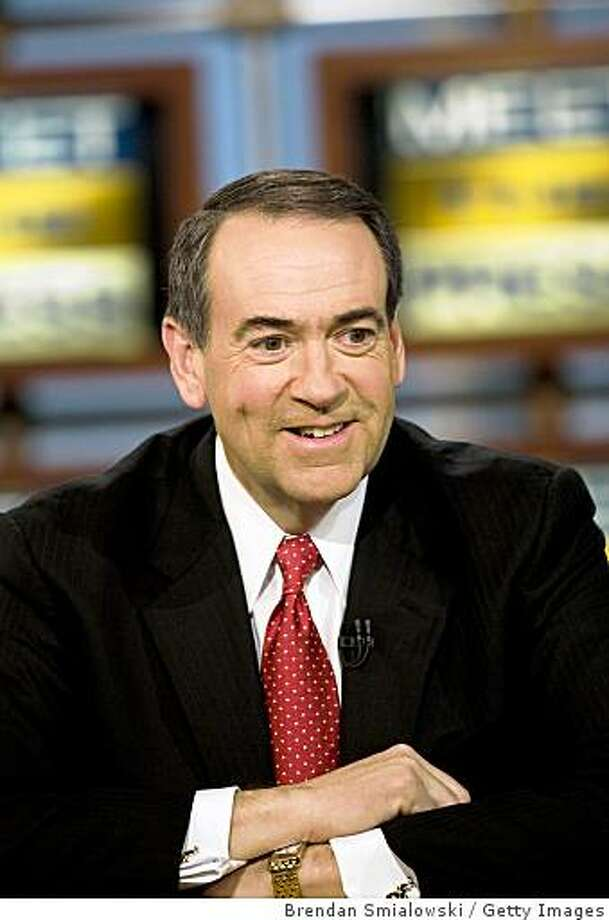 WASHINGTON - FEBRUARY 10:  Republican presidential candidate former Arkansas Gov. Mike Huckabee smiles during a interview about his campaign for the Republican nomination during a live taping of Meet the Press February 10, 2008 in Washington, DC. Huckabee and others spoke on the program about the 2008 U.S. presidential election.  (Photo by Brendan Smialowski/Getty Images for Meet The Press) Photo: Brendan Smialowski, Getty Images