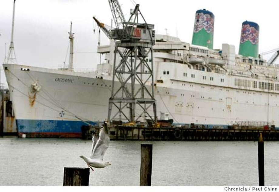 A gull takes flight in front of the ocean liner Oceanic docked at the Pier 70 shipyard in San Francisco, Calif. on Tuesday, Jan. 29, 2008. The ship, formally known as the Independence, is one of the last American-built cruise ships still plying the waters MANDATORY CREDIT FOR PHOTOGRAPHER AND S.F. CHRONICLE/NO SALES - MAGS OUT Photo: PAUL CHINN