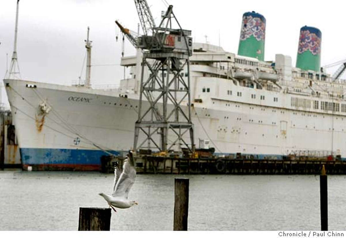 A gull takes flight in front of the ocean liner Oceanic docked at the Pier 70 shipyard in San Francisco, Calif. on Tuesday, Jan. 29, 2008. The ship, formally known as the Independence, is one of the last American-built cruise ships still plying the waters MANDATORY CREDIT FOR PHOTOGRAPHER AND S.F. CHRONICLE/NO SALES - MAGS OUT