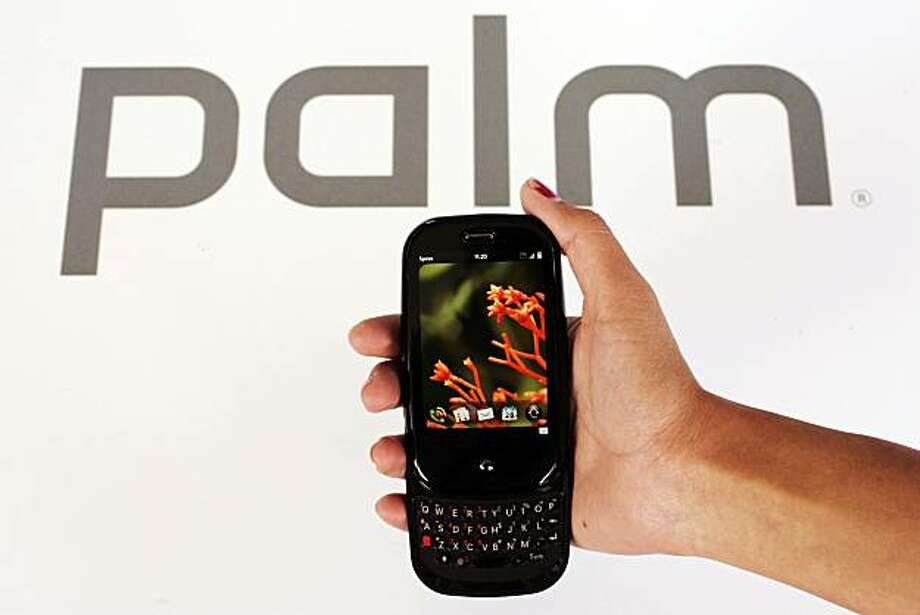 In this photo taken Thursday, May 28, 2009, the Palm Pre is shown at Palm headquarters in Sunnyvale, Calif. Industry watchers view the Pre as a make-or-break product for the beleaguered handset maker: Its success could signal Palm's resurgence in a market largely dominated by Apple Inc.'s iPhone and Research In Motion Ltd.'s BlackBerry handsets, while failure may spell the end of the very company that helped usher in the handheld computing era with the release of the original Palm Pilot in 1996. (AP Photo/Paul Sakuma) Photo: Paul Sakuma, AP