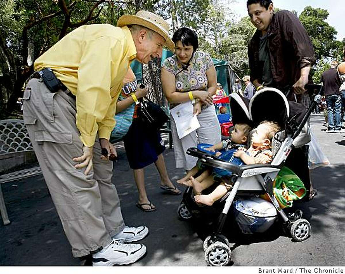 Dr. Donald Galen, who was responsible for many of the children in attendance, stopped to talk with the Guzman family and their twins Saul and Andres. The Reproductive Science Center, who specialize with in vitro fertilization (IVF), held a reunion picnic Sunday June 14, 2009, inviting back many of their patients and their IVF-created children at Little Hills Ranch in San Ramon.