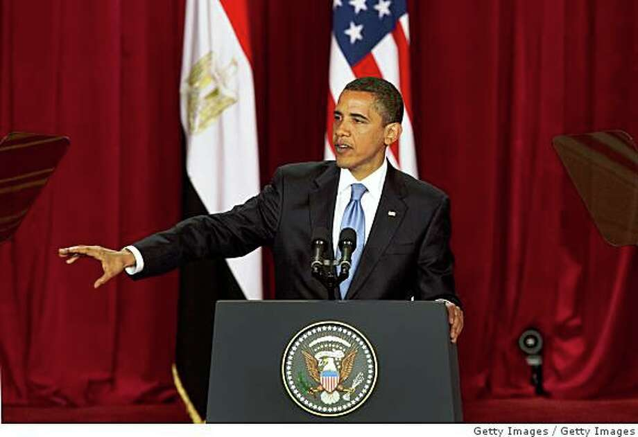 """CAIRO, EGYPT - JUNE 4:  U.S. President Barack Obama makes his key Middle East speech at  Cairo University June 4, 2009 in Cairo, Egypt. In his speech, President Obama called for a """"new beginning between the United States and Muslims"""", declaring that """"this cycle of suspicion and discord must end"""".  (Photo by Getty Images) Photo: Getty Images"""