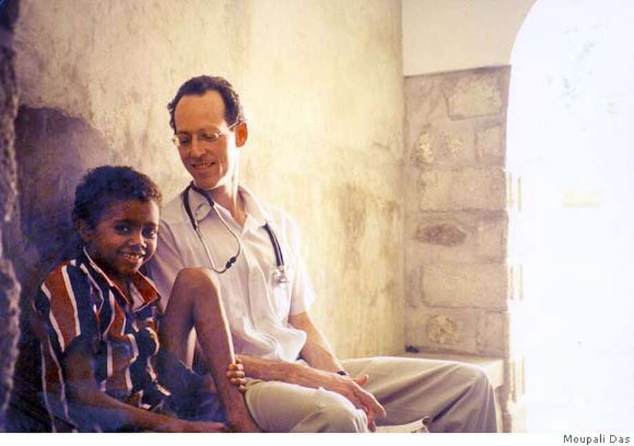 FARMER-alcante For Book Review, cover art ; Dr. Paul Farmer (right) in Haiti with Alcante; Photo Credit: Moupali Das ; on 9/11/03 in . Moupali Das / HO Ran on: 05-14-2005  Dr. Paul Farmer, seen here with a patient in Haiti, will deliver the commencement address at the UC Berkeley School of Public Health. Ran on: 05-14-2005  Dr. Paul Farmer, seen here with a patient in Haiti, will deliver the commencement address at the UC Berkeley School of Public Health. Photo: Moupali Das