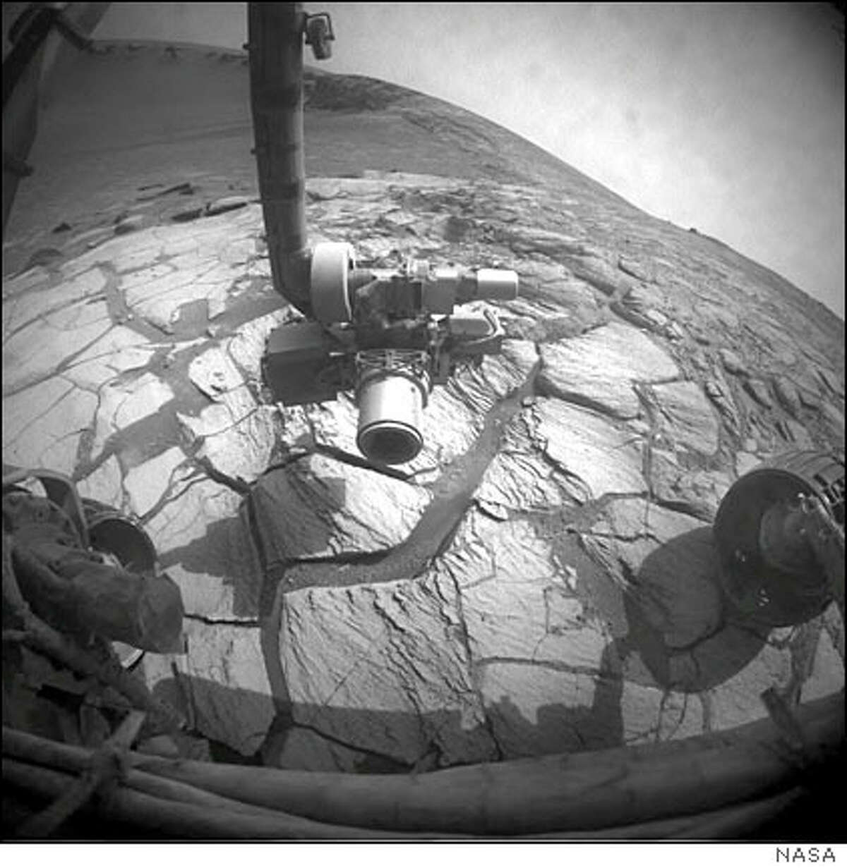 This photo released by NASA, taken by the Mars rover Opportunity's front hazard-identification camera, shows a wide-angle view looking down into and across Victoria Crater. NASA's rover Opportunity has reached its first stop inside a huge Martian crater and was poised Thursday to carry out the first science experiments but will have to delay its science experiments because of a malfunction on Earth. (AP Photo/NASA, JPL-Caltech)