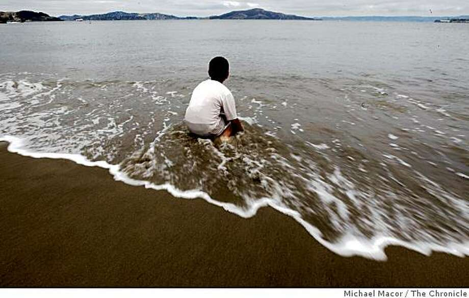 9-year-old Arturo Gullen plays along the beach at Crissy Field, in San Francisco, Calif.  on Wednesday June 10, 2009. Photo: Michael Macor, The Chronicle