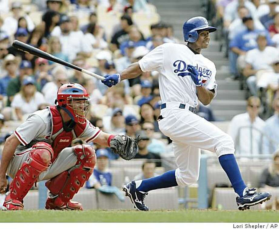 Los Angeles Dodgers' Juan Pierre hits a single against the Philadelphia Phillies during the seventh inning of a baseball game in Los Angeles, Saturday, June 6, 2009.  (AP Photo/Lori Shepler) Photo: Lori Shepler, AP