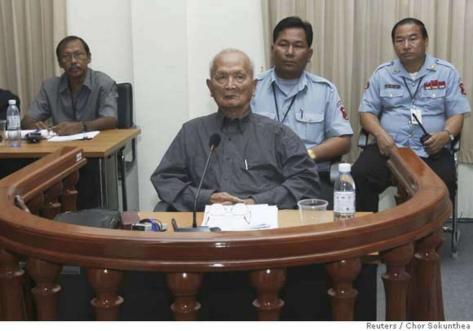 "Nuon Chea, Pol Pot's right hand man of the Khmer Rouge regime, sits in the dock during his first public appearance at the Extraordinary Chambers in the Courts of Cambodia (ECCC) on the outskirts of Phnom Penh February 4, 2008. Noun Chea stood before the U.N.-backed ""Killing Fields"" tribunal on Monday in the second public appearance by a senior Pol Pot cadre. REUTERS/Chor Sokunthea (CAMBODIA) Photo: CHOR SOKUNTHEA"