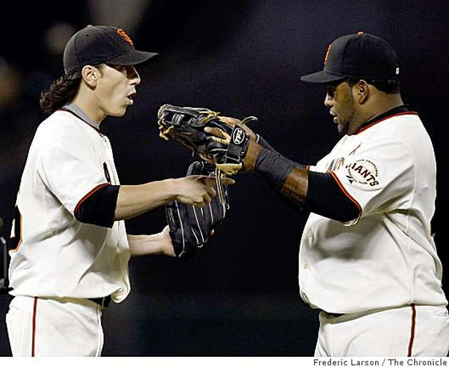 Tim Lincecum (left) and Pablo Sandoval congratulate themselves after Linceum pitches a complete game shut out against the Oakland Athletics at AT&T Park in San Francisco, Calif., on June 12, 2009. Photo: Frederic Larson, The Chronicle