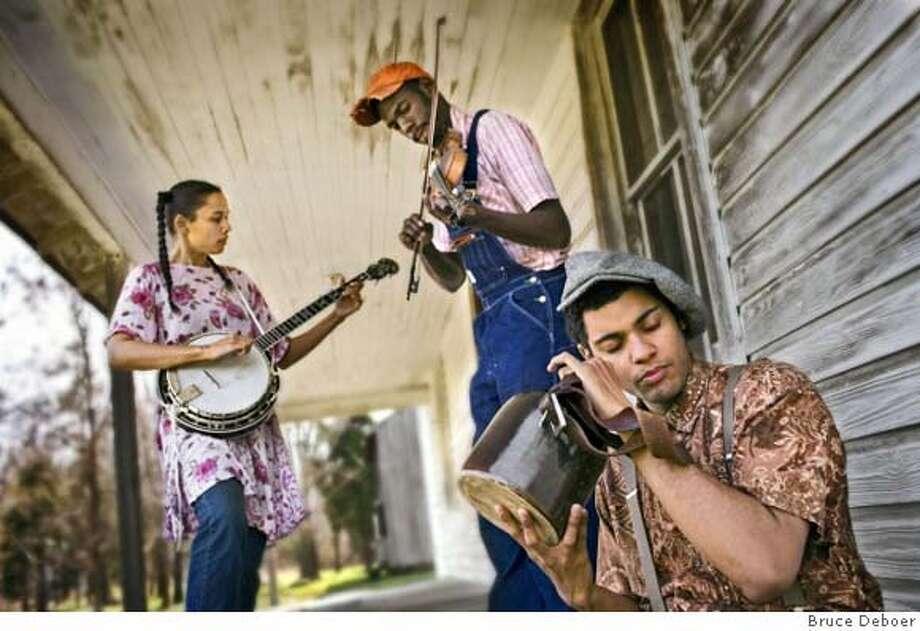 Rhiannon Giddens on banjo, fiddle and vocals, Justin Robinson on fiddle and vocals and Dom Flemons on banjo, guitar, jug, harmonica, snare and vocals. Photo: Bruce Deboer