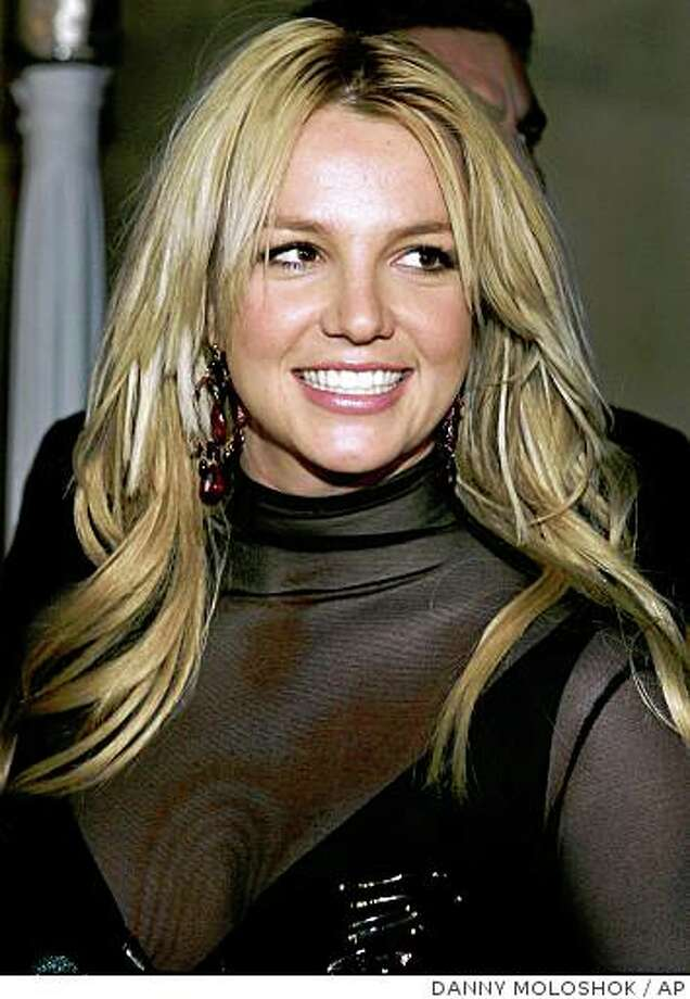 **FILE** In a file photo Britney Spears arrives for a post Grammy Awards party at a private residence  Feb. 8, 2006, in Beverly Hills, Calif. Britney Spears was taken from her house by ambulance early Thursday,Jan. 31, 2008,Los Angeles  police said.(AP Photo/Danny Moloshok/file) Photo: DANNY MOLOSHOK, AP