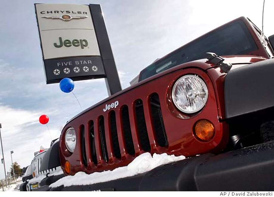 Unsold 2008 Jeep Wranglers sit at a Chrysler/Jeep dealership in the southeast Denver suburb of Centennial, Colo., on Sunday, Feb. 3, 2008. When thousands of U.S. auto dealers gather in San Francisco this weekend, much of the talk will be about just getting through 2008. The obstacles include a shaky economy, volatile stock market and tightening credit, setting up what economists are predicting could be the worst sales year in more than a decade. (AP Photo/David Zalubowski) Photo: David Zalubowski