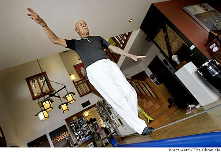 Grbich finds a focus point as he looks out at a view of the Bay Area when using his tightwire mechanism. Mike Grbich, 77, a retired high school teacher, has a 14-foot tightwire sitting on the floor of his Oakland Hills home. He also dances and is an accomplished painter. Photo: Brant Ward, The Chronicle