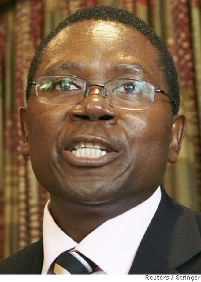 Simba Makoni, a senior member in Zimbabwe's ruling ZANU-PF party, announces his intention to run for president at a news conference in Harare February 5, 2008. Makoni's announcement to run in the March 29 election is the first major internal challenge to President Robert Mugabe in 20 years. Makoni said he had decided to run after consultations with party members and activists across Zimbabwe. Despite economic turmoil, 83-year-old Mugabe had been expected to win the election against a weak and divided opposition. REUTERS/Stringer (ZIMBABWE) 0 Photo: STRINGER/ZIMBABWE