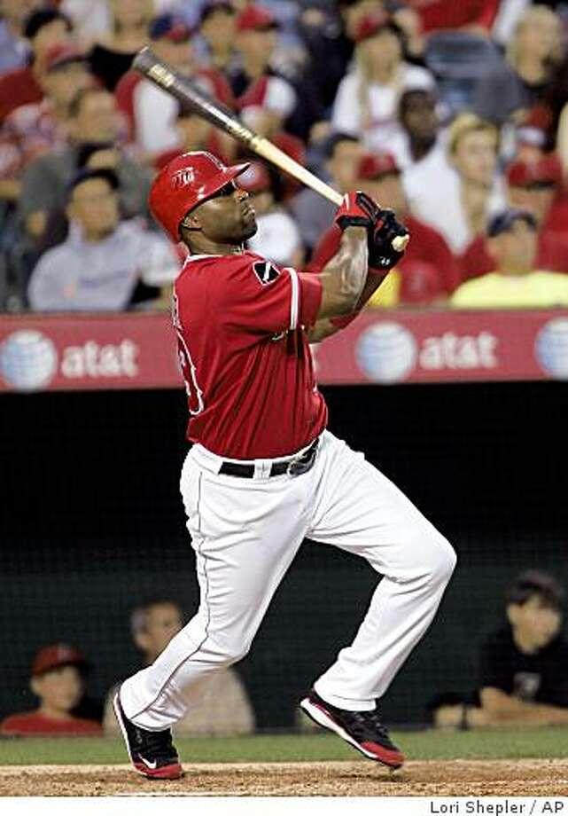 Los Angeles Angels' Torii Hunter watches his solo home run against the San Diego Padres during the seventh inning of a baseball game in Anaheim, Calif., Saturday, June 13, 2009.  (AP Photo/Lori Shepler) Photo: Lori Shepler, AP