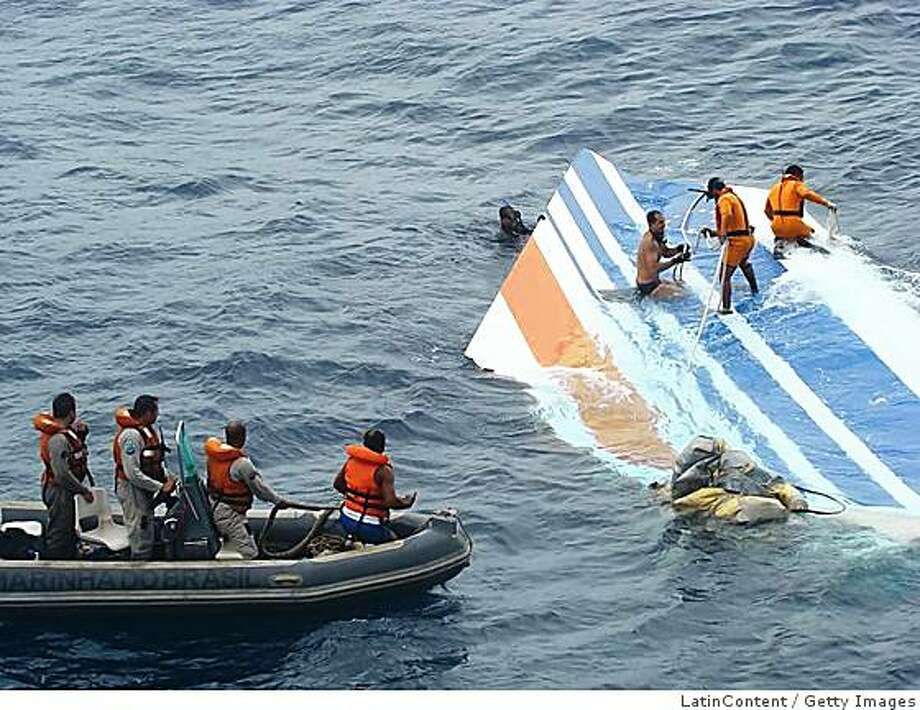 BRAZIL - JUNE 08:  This handout image released by the Brazilian Air Force (FAB) shows crew members preparing to tow a part of the wreckage of a Air Bus A330-200 jetliner which crashed in the Atlantic Ocean with 228 people on board in a flight from Rio de Janeiro to Paris on June 8, 2009 . So far search operations have found 16 bodies of victims from Air France flight 447.  (Photo by Forca Aerea Brasileira via LatinContent/Getty Images) Photo: LatinContent, Getty Images