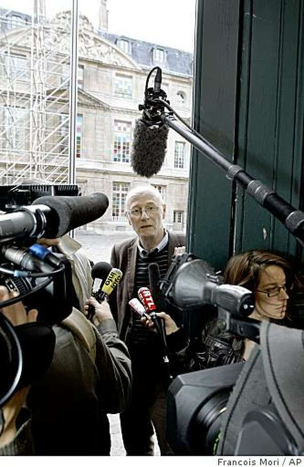 "Picasso Museum secretary Fabien Docaigne, speaks to reporters at the front door of Picasso Museum in Paris, Tuesday June 9, 2009 after a notebook of 33 pencil drawings, reportedly worth several million euros (dollars), by Spanish born artist Pablo Picasso has been stolen from the Paris museum that bears the painter's name. The stolen sketchbook, was shiny red with the word ""Album"" inscribed in gold on the front, dated from 1917 to 1924, the Culture Ministry statement said. (AP Photo/Francois Mori) Photo: Francois Mori, AP"