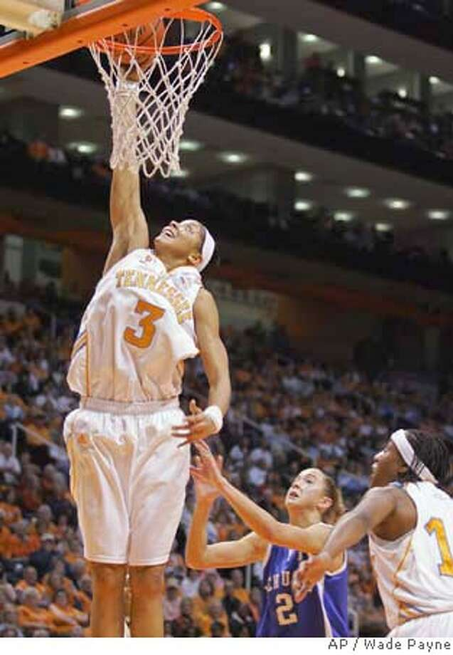 Tennessee's Candace Parker (3) dunks the ball in front of Kentucky's Chelsea Chowning (2) during the second of a college basketball game Sunday, Feb. 3, 2008, in Knoxville, Tenn. Parker scored 20 points as Tennessee won, 79-51. (AP Photo/Wade Payne) EFE OUT Photo: Wade Payne