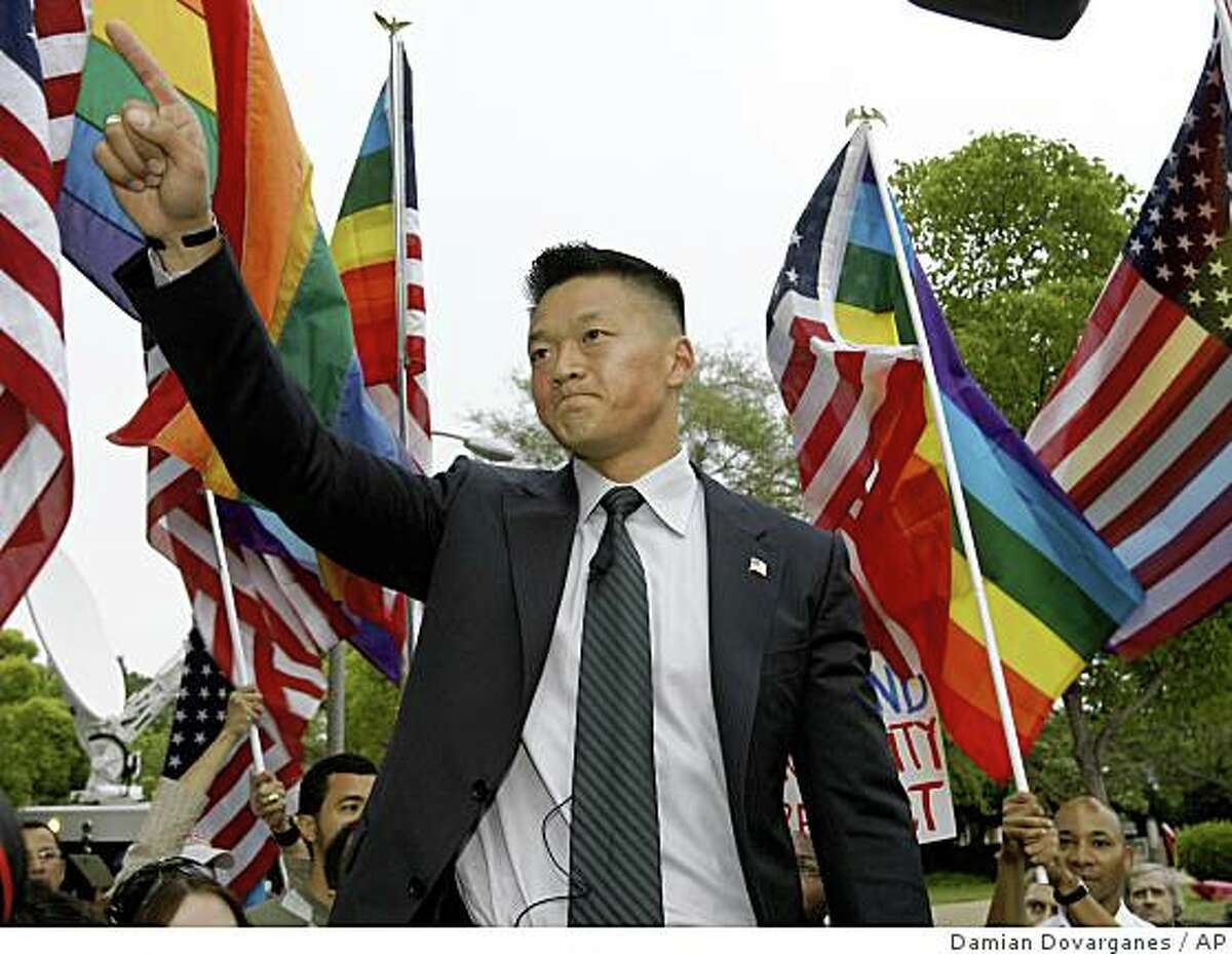 Former Army National Guard Lt. Dan Choi, an Arabic-speaking specialist dismissed through the 'Don't Ask, Don't Tell' policy, comments on Proposition 8, outside the Beverly Hills hotel, where U.S. President Barack Obama attended a benefit dinner in Beverly Hills, Calif. on Wednesday, May 27, 2009.