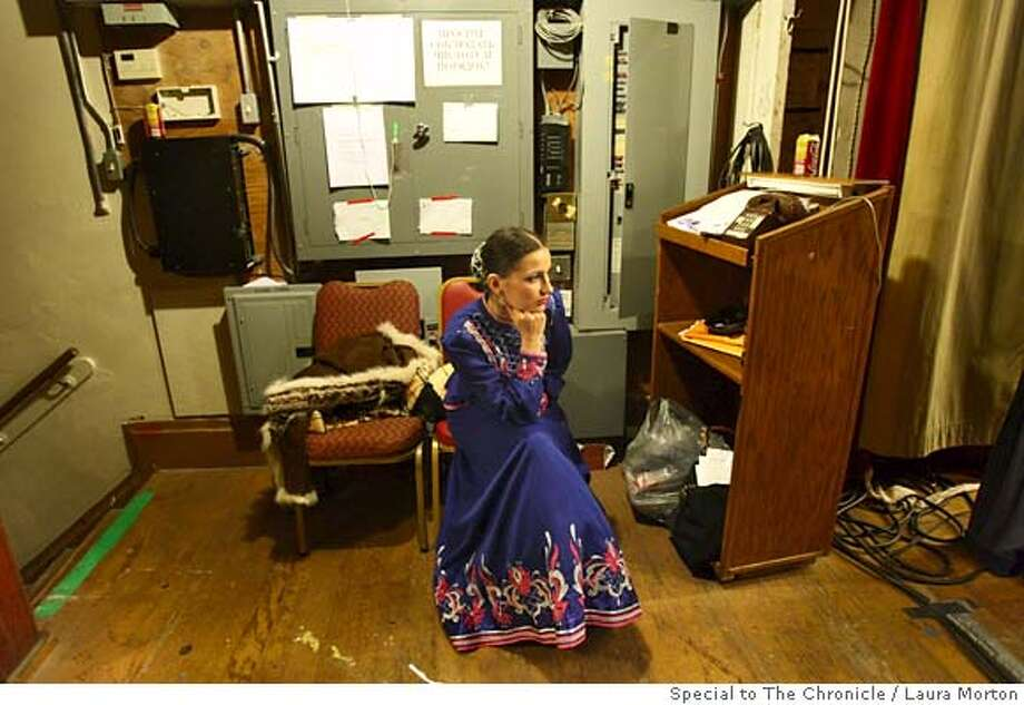 Natalia Kesel, a member of the State Don Cossacks Company from Russia, waits backstage to perform at the Russian Festival at the Russian Center of San Francisco on Friday night. Friday night's performance was the first time the group appeared in the United States. (Laura Morton/Special to the Chronicle) Photo: Laura Morton