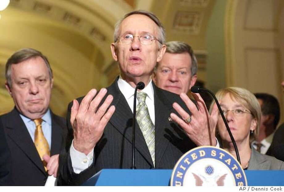 Senate Majority Leader Harry Reid of Nev., second from left, meets reporters on Capitol Hill in Washington, Thursday, Feb. 7, 2008, after Senate Democrats and Republicans reached agreement on an economic stimulus package. From left are, Sen. Richard Durbin, D-Ill., Reid, Sen. Max Baucus, D-Mont., and Sen. Patty Murray, D-Wash. (AP Photo/Dennis Cook) Photo: Dennis Cook