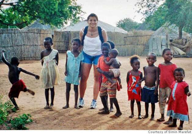 Simin Marefat poses with a group of children from a recent trip to Africa in this photograph. The registered nurse has travelled independently to over 60 countries and showed up at orphanages and clinics to volunteer her medical expertise.  PHOTO: COURTESY OF SIMIN MAREFAT Photo: COURTESY OF SIMIN MAREFAT