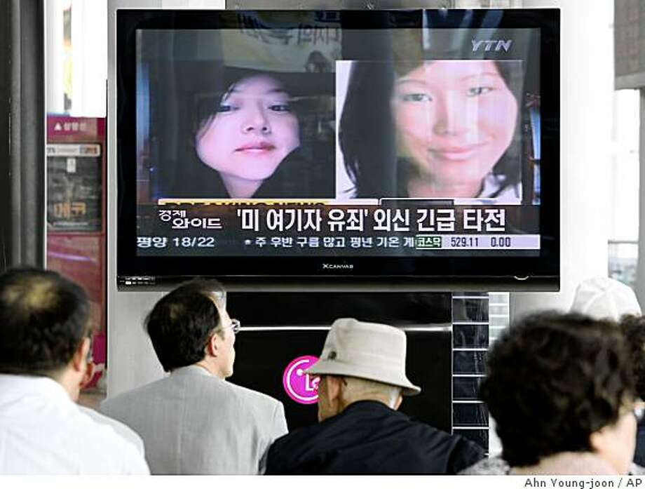 "South Koreans watch a TV broadcasting news about two American journalists detained in North Korea at the Seoul Railway Station, in South Korea, Monday, June 8, 2009.  North Korea's top court convicted the journalists and sentenced them to 12 years in a prison Monday, intensifying the reclusive nation's confrontation with the United States. The headline reads ""American journalists were found guilty."" (AP Photo/Ahn Young-joon) Photo: Ahn Young-joon, AP"