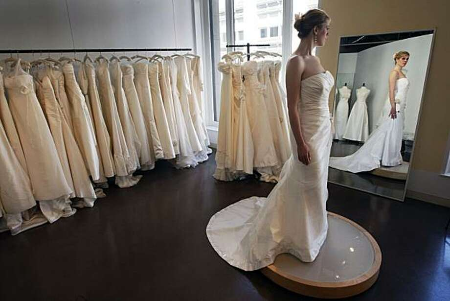Maddie Combs models A Adele Wechsler wedding gown at Marina Morrison Bridal Salon in San Francisco Friday April 17, 2009 Photo: Lance Iversen, The Chronicle