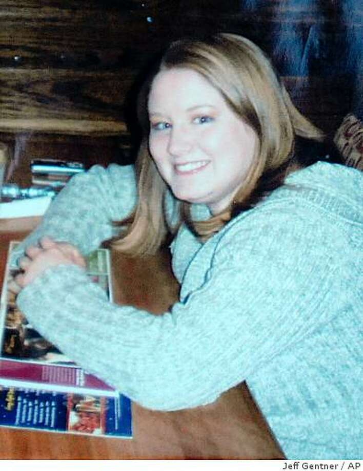 "This undated photo released by the Kidd family, shows Heather M. Snively. Police say the body of 21-year-old Snively, though not her infant, was found dead Friday in the crawl space of a house in the Portland suburb Beaverton, Ore. A 27-year-old Beaverton woman, Korena Elaine Roberts, was charged with her murder. An autopsy report on the killing of the woman who had been eight months pregnant says she died of ""blunt force"" and ""sharp force"" injuries, but a medical examiner won't say how her child died. Photo: Jeff Gentner, AP"