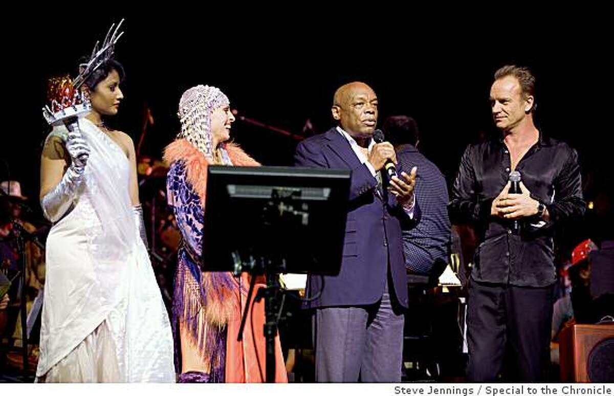 """The Honorable Willie Brown is joined by Sting (and the Statue of Liberty and a flapper)Sting made a rare San Francisco appearance at """"Let the Sunshine In,"""" a star studded event at Davies symphony hall benefiting Oakland shooting victim Christopher Rodriguez, the San Francisco Conservatory of Music and the Narada Michael Walden Foundation."""
