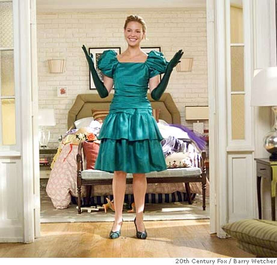 "(NYT57) UNDATED -- Jan. 9, 2008 -- BRIDESMAIDS-FASHION-2 -- Katherine Heigl, a bridesmaid in ""27 Dresses."" In the bridal industry, which traditionally has been several beats behind current fashion, the news is that bridesmaids dresses are beginning to mirror runway trends. Meaning that conventional prom looks and crinoline-propped frocks are losing ground to pert bubble and trapeze shapes. (Barry Wetcher/20th Century Fox via The New York Times)**ONLY FOR USE WITH STORY BY RUTH LA FERLA SLUGGED: BRIDESMAIDS-FASHION. ALL OTHER USE PROHIBITED.  Ran on: 01-18-2008  Katherine Heigl plays a wannabe wife in &quo;27 Dresses.&quo;  Ran on: 02-03-2008  Watching Katherine Heigl is not a bad way to make a living. Photo: BARRY WETCHER"
