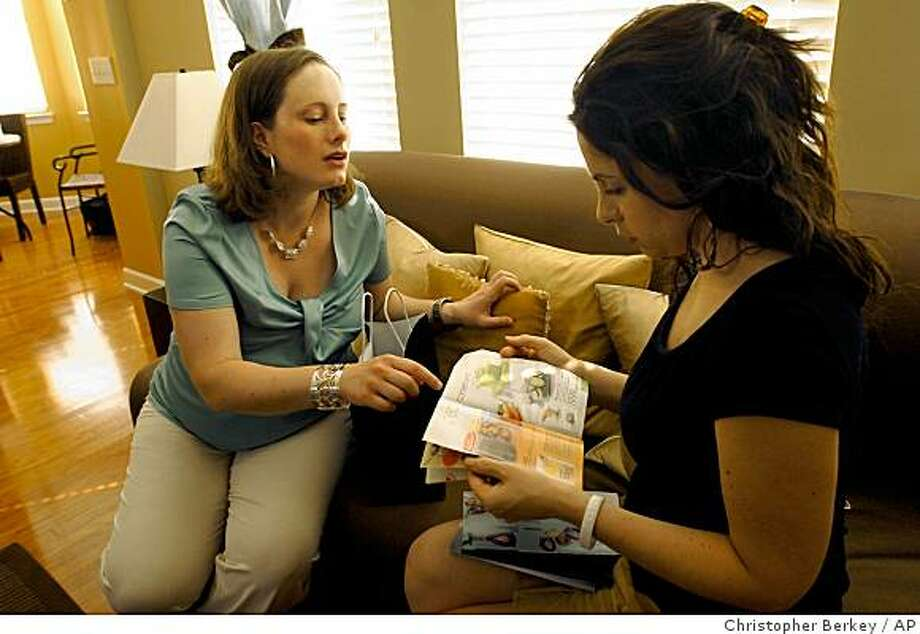 In a Friday, May 15, 2009 photo, Melanie Lyke, left, discusses Avon products with her client, Jennifer Jarnagin, right, in Jarnagin's home in Franklin, Tenn. Lyke sells Avons products as a way to earn a second income. (AP Photo/Christopher Berkey) Photo: Christopher Berkey, AP