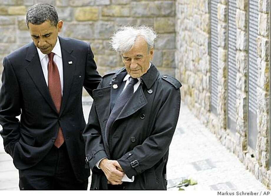 US President Barack Obama, left, and Buchenwald survivor Elie Wiesel, right, react at the memorial site for the 'Kleines Lager' (Little Camp) inside Buchenwald concentration camp near Weimar, Germany, Friday, June 5, 2009. Obama who is en route from Egypt to France, will visit Dresden, the former Nazi concentration camp Buchenwald and the US regional medical center in Landstuhl during his stopover in Germany.  (AP Photo/Markus Schreiber, Pool) Photo: Markus Schreiber, AP