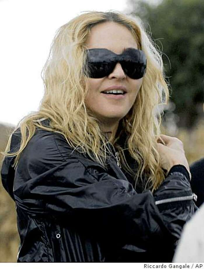 FILE - In this April 3, 2009 file photo, Madonna visits a development project in Gumulira, Malawi. Madonna can adopt a second child from Malawi, the southern African country's highest court ruled Friday, June 12, 2009, overturning a lower court decision it said was out of touch with the times. (AP Photo/Riccardo Gangale, file) Photo: Riccardo Gangale, AP