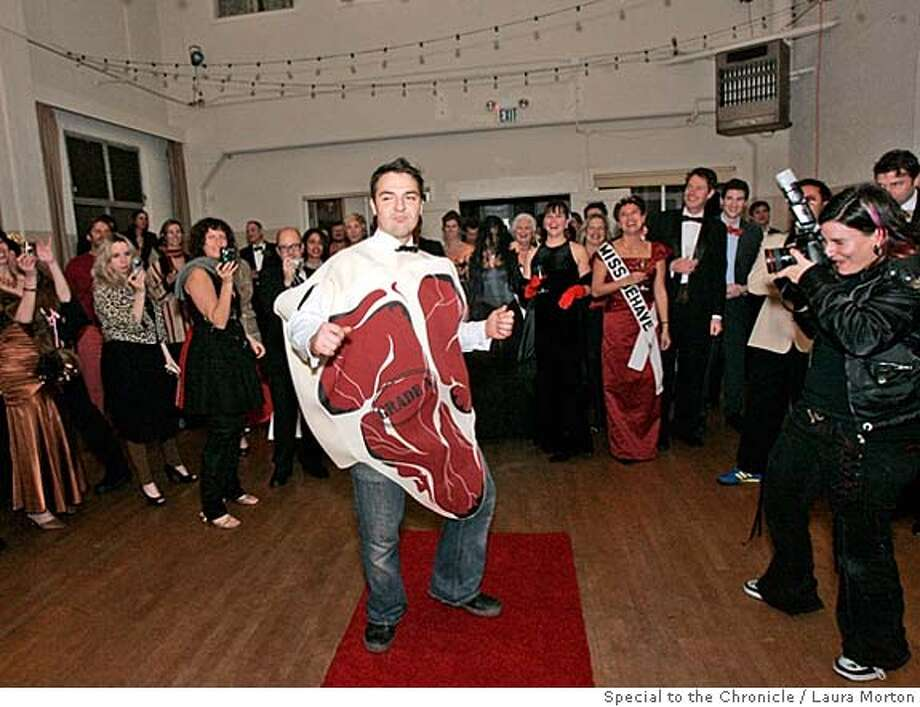 Borys Saciuk dances down the red carpet in a steak costume while competing in the fashion show during the Meat Ball, a meat theme birthday party that was held at Slovenian Hall in San Francisco. The inspiration for the party came from a long standing feud between two friends over who makes the best meatballs. (Laura Morton/Special to the Chronicle) Photo: Laura Morton