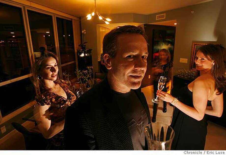 "bachelor_007_el.jpg  Photo Illustration by Eric Luse  Friends Midori Inagaki, left, Ron Jankov and Kenzi Parton in the living room/dining room. Designer Lawanna Endonino is in the back of the room join Ron for a glass of Champagne.  Ron Jankov's ""bachelor pad"" in San Francisco. The design work was done by Lawanna Endonino. Eric Luse / The Chronicle Photo taken on 1/11/08, in San Francisco, CA, USA  Name cq by source  Lawanna Endonino  Ron Jankov  Midori Inagaki Photo: Eric Luse"