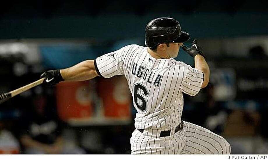 Florida Marlins batter Dan Uggla gets his second hit of the game, a single with one RBI during baseball action in the third inning of the Tuesday, June 2, 2009 game in Miami.  (AP Photo/J Pat Carter) Photo: J Pat Carter, AP
