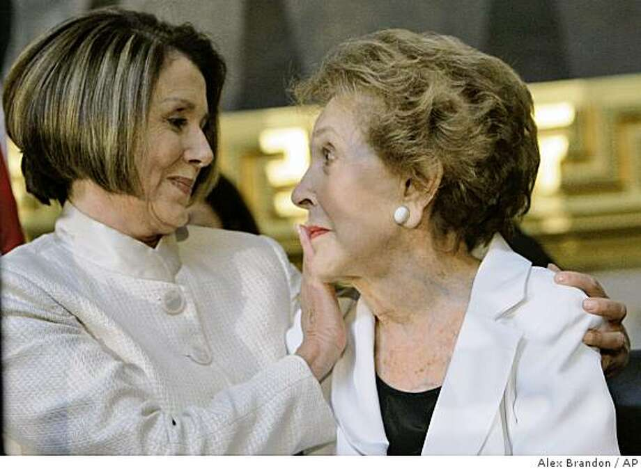 House Speaker Nancy Pelosi of Calif. wipes a tear from former first lady Nancy Reagan in the Rotunda of the Capitol in Washington, Wednesday, June 3, 2009, during a ceremony unveiling he Ronald Reagan statue. (AP Photo/Alex Brandon) Photo: Alex Brandon, AP