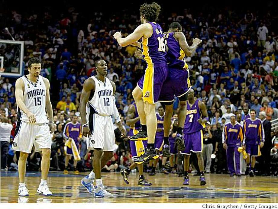 ORLANDO, FL - JUNE 11:  Pau Gasol #16 and Trevor Ariza #3 of the Los Angeles Lakers celebrates in the final moments of the Lakers' overtime win over the Orlando Magic in Game Four of the 2009 NBA Finals on June 11, 2009 at Amway Arena in Orlando, Florida.  NOTE TO USER:  User expressly acknowledges and agrees that, by downloading and or using this photograph, User is consenting to the terms and conditions of the Getty Images License Agreement.  (Photo by Chris Graythen/Getty Images) Photo: Chris Graythen, Getty Images
