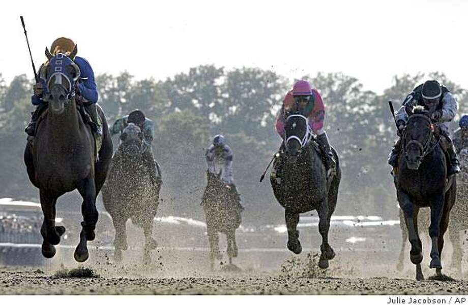 Summer Bird, left, ridden by Kent Desormeaux, Charitable Man,center, ridden by Alan Garcia and Mine That Bird, right, ridden by Calvin Borel race towards the finish during the 141st running of the Belmont Stakes horse race at Belmont Park, Saturday, June 6, 2009, in Elmont, N.Y.  Summer Bird won the race.  (AP Photo/Julie Jacobson) Photo: Julie Jacobson, AP