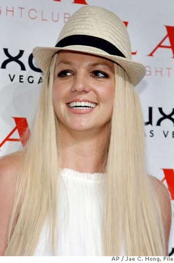 ** FILE ** Britney Spears arrives for the grand opening party of LAX nightclub at the Luxor hotel-casino in Las Vegas, in a Sept. 1, 2007 file photo. Britney Spears was taken from her house by ambulance early Thursday,Jan. 31, 2008,Los Angeles police said. (AP Photo/Jae C. Hong, File) SEPT 1, 2007 FILE PHOTO Photo: Jae C. Hong
