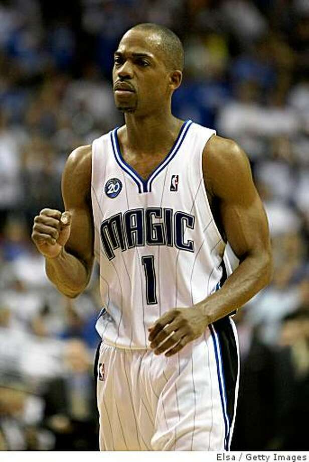 ORLANDO, FL - MAY 30: Rafer Alston #1 of the Orlando Magic pumps his fist late in the game against the Cleveland Cavaliers in Game Six of the Eastern Conference Finals during the 2009 Playoffs at Amway Arena on May 30, 2009 in Orlando, Florida. NOTE TO USER: User expressly acknowledges and agrees that, by downloading and or using this photograph, User is consenting to the terms and conditions of the Getty Images License Agreement  (Photo by Elsa/Getty Images) Photo: Elsa, Getty Images