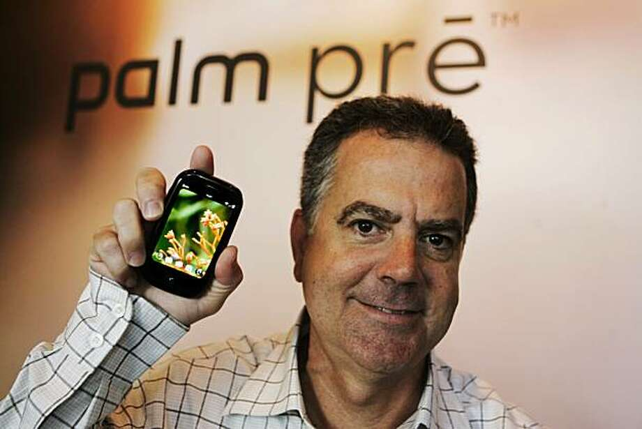 In this photo taken Thursday, May 28, 2009, Palm CEO Ed Colligan poses with a Palm Pre at Palm headquarters in Sunnyvale, Calif.  Industry watchers view the Pre as a make-or-break product for the beleaguered handset maker: Its success could signal Palm's resurgence in a market largely dominated by Apple Inc.'s iPhone and Research In Motion Ltd.'s BlackBerry handsets, while failure may spell the end of the very company that helped usher in the handheld computing era with the release of the original Palm Pilot in 1996. (AP Photo/Paul Sakuma) Photo: Paul Sakuma, AP