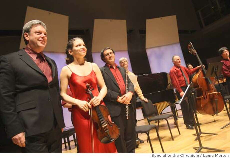 Conductor David Milnes (left) and violinist Carla Kihlstedt take a bow with the rest of the ensemble after presenting the world premier of Jorge Liderman's piece Furthermore at the Yerba Buena Center for the Arts Forum on Monday night. (Laura Morton/Special to the Chronicle) Ran on: 02-06-2008  Conductor David Milnes (left), violinist Carla Kihlstedt and other musicians at the premiere of Jorge Liderman's &quo;Furthermore{hellip}&quo; Photo: Laura Morton