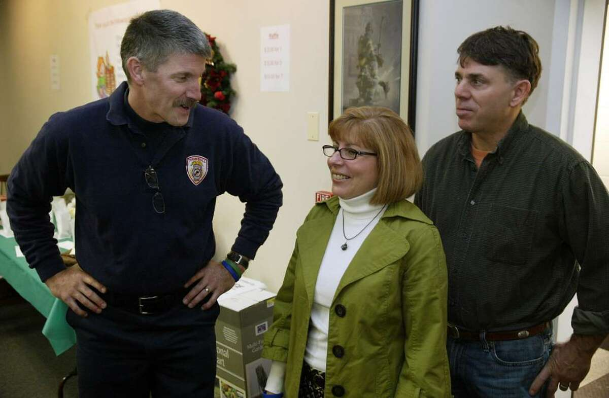 (L-R) Trumbull volunteer firefighter, David Blackmore talks with Michele Williams and her husband Jeff during a benefit pancake breakfast at Trumbull Volunteer Fire Headquarters for Michelle's son Alex Convertito, seriously injured an a car crash on Route 8 in September, Nov. 8, 2009.