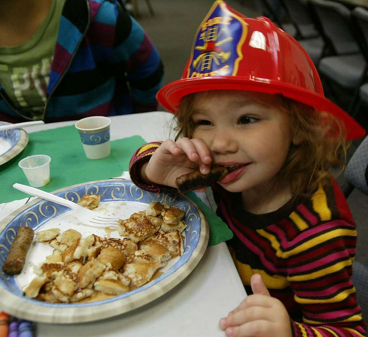 Samantha Buttress, enjoys a pancake breakfast at the Trumbull Volunteer Fire Station on White Plains Road. The breakfast was a fundraising benefit for Alex Convertito, the 22 year old seriously injured in a September crash on Route 8, Sunday, Nov. 8, 2009.