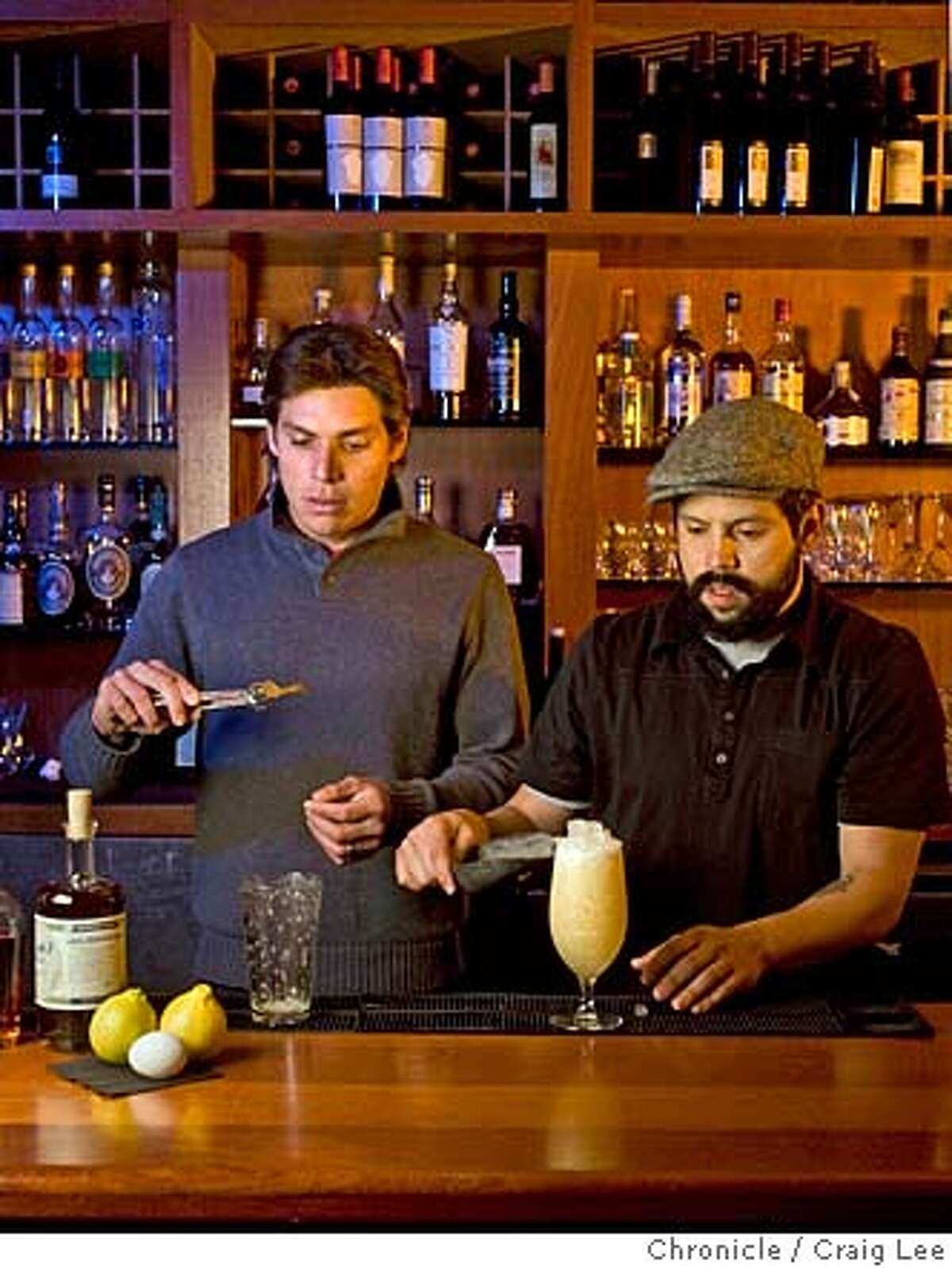 Dominic Venegas (wearing hat and black shirt) and Carlos Yturria, bartenders at Bacar restaurant. Photo of them making their drink called Family Style. The drink is made with Elijah Craig 12 year, Bergamot Orange, Hanger St. George Alosinthe, Agave Nectar, egg white, shaken and served over crushed ice topped with a fried Bergamot peel. on 1/22/08 in San Francisco. photo by Craig Lee / The Chronicle MANDATORY CREDIT FOR PHOTOG AND SF CHRONICLE/NO SALES-MAGS OUT
