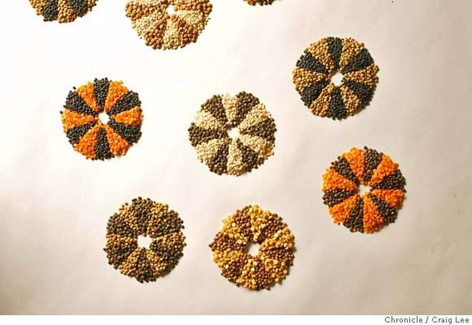"""Cooking in Common"" feature on lentils, which are used in cultures around the world, especially in India, France and Italy. 1) cover shot: mosaic-like art with multicolored lentils on 1/23/08 in San Francisco. photo by Craig Lee / The Chronicle MANDATORY CREDIT FOR PHOTOG AND SF CHRONICLE/NO SALES-MAGS OUT Photo: Photo By Craig Lee"